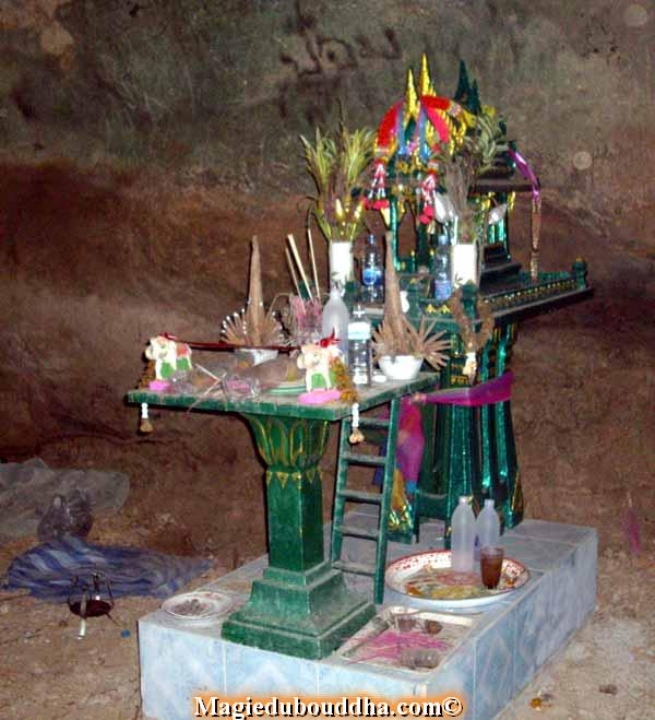 thai spirit house in cave